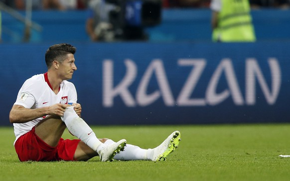 Poland's Robert Lewandowski sits on the pitch during the group H match between Poland and Colombia at the 2018 soccer World Cup at the Kazan Arena in Kazan, Russia, Sunday, June 24, 2018. (AP Photo/Frank Augstein)