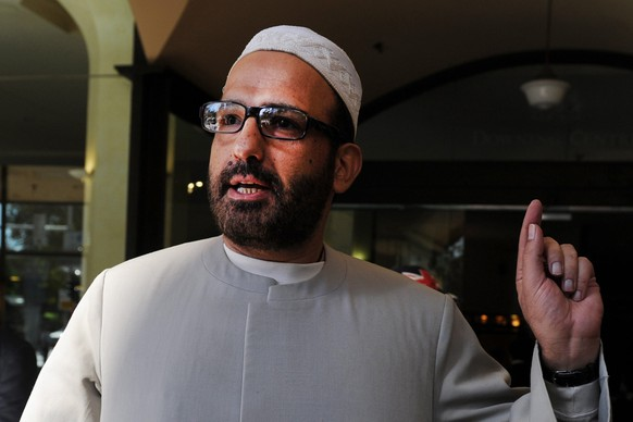 epa04530319 A picture made available 15 December 2014 shows Muslim cleric Man Haron Monis arriving to the Downing Centre after a pre-trial hearing of his case, in Sydney, Australia, 18 April 2011.  According to news reports on 15 December 2014 citing police, Man Haron Monis has allegedly been identified by police as the hostage-taker at a cafe in downtown Sydney, Australia. A number of hostages were being held inside a Lindt cafe, after witnesses reported gunshots and footage showed an Islamist flag held up to the window.  EPA/DEAN LEWINS AUSTRALIA AND NEW ZEALAND OUT