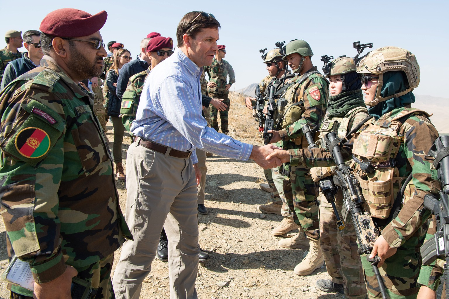 epa07940226 A handout photo made available by the US Department of Defense (DOD) shows US Defense Secretary Mark T. Esper (C) meeting with members of the Afghan special forces to observe their training at Camp Commando, Afghanistan, 21 October 2019 (issued 22 October 2019). According to reports, Defense Secretary Esper said that the reduction od US forces in Afghanistan relies on a peace agreement with the Taliban.  EPA/STAFF SGT. BRANDY NICOLE MEJIA/US DEPARTMENT OF DEFENSE HANDOUT  HANDOUT EDITORIAL USE ONLY/NO SALES
