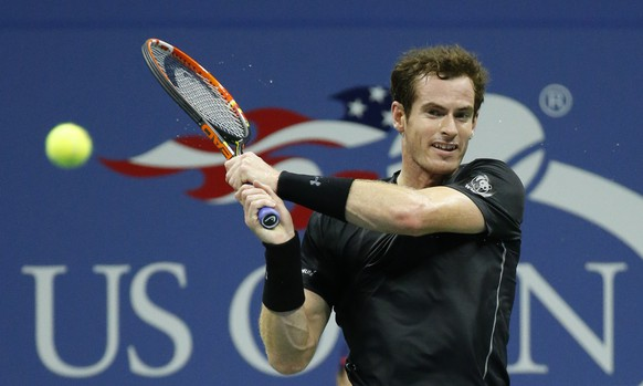 Andy Murray, of Britain, returns a shot to Thomaz Bellucci, of Brazil, during the third round of the U.S. Open tennis tournament in New York, Saturday, Sept. 5, 2015. (AP Photo/Julio Cortez)