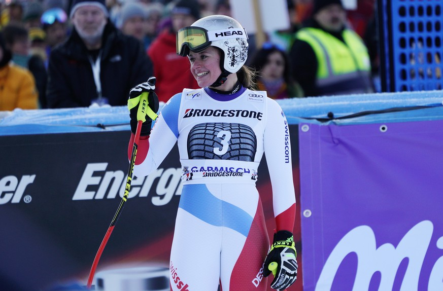 Switzerland's Corinne Suter reacts after competing at the finish area during an alpine ski, women's World Cup downhill, in Garmisch Partenkirchen, Germany, Sunday, Jan. 27, 2019. (AP Photo/Giovanni Auletta)