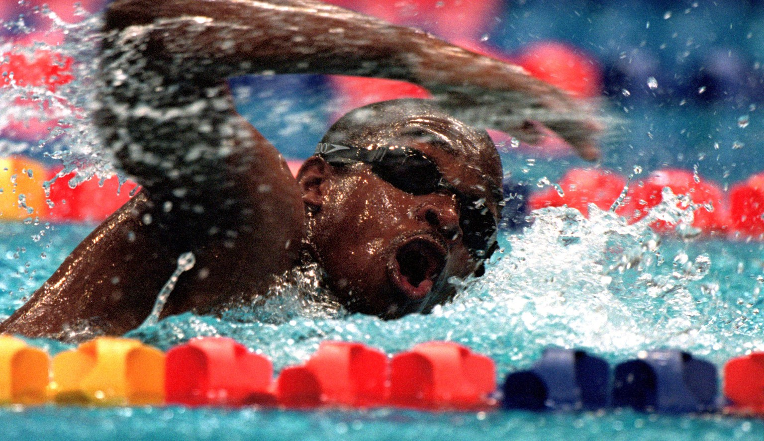 19 Sep 2000:  Eric ''the Eel'' Moussambani of Equatorial Guinea in action during the Mens 100m Freestyle Heats at the Sydney International Aquatic Centre on Day Four of the Sydney 2000 Olympic Games in Sydney, Australia. Moussambani completed the swim in atime of 1:52.72, over a minute behind the World Record for the distance.  \ Mandatory Credit: Stu Forster /Allsport