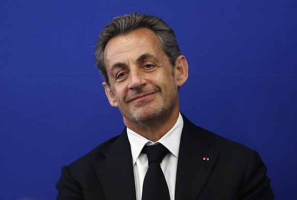 Former French President Nicolas Sarkozy attends the inauguration of the Institut Claude Pompidou, a new centre for care and research of Alzheimer disease, in Nice in this March 10, 2014 file photo. France's former president Nicolas Sarkozy announced his return to politics on Friday September 19, 2014 , declaring he would seek the leadership of the opposition UMP in a move that would position him for a 2017 presidential bid. The announcement on his Facebook page ends months of local media speculation that the 59-year-old conservative would return to the fray after his defeat by Socialist Francois Hollande in 2012. Sarkozy said