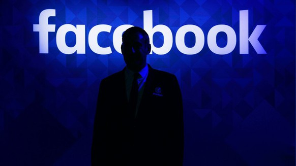 A security guard stands at the entrance to the Facebook Inc. lounge at the Web Summit in Dublin, Ireland on Tuesday, Nov. 3, 2015. The summit, which started five years ago with 400 technology entrepreneurs, will draw more than 2,000 startups, 1,000 investors and 650 speakers to the three-day conference this year, organizers say. Photographer: Aidan Crawley/Bloomberg via Getty Images