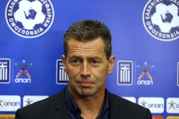 The new national soccer team coach Michael Skibbe of Germany makes statements after signing a contract with the Greek football association in Athens, Friday, Oct. 30, 2015. The 50-year-old former Schalke player takes the position after the country's disastrous European Championship qualifying campaign. (AP Photo/Thanassis Stavrakis)
