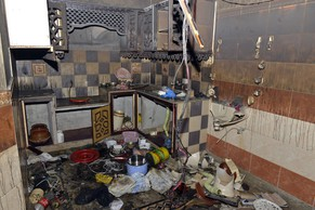 The interior of a torched house belonging to an Ahmadi Muslim resident is pictured following an attack by an angry mob in the low-income Arafat Colony of the eastern city of Gujranwala, some 112 kilometres north of Lahore, on July 28, 2014. An angry mob in Pakistan torched an Ahmadi Muslim minority neighbourhood killing a woman and two girls in a row over blasphemy, police said, in the latest attack on one of the country's most persecuted groups. AFP PHOTO/Arif ALI
