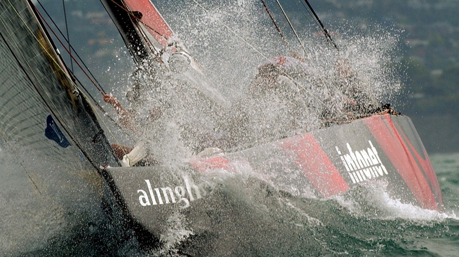 Swiss Defi yacht Alinghi, SUI-64, sailing in a wave during the fifth match-race against the New Zealander defender yacht, Team New Zealand, NZL-82, during the America's Cup final, in Hauraki gulf, near Auckland, New Zealand, Sunday, March 2, 2003. Alinghi won today's race by 45 seconds that brings the score to 5: 0 for Alinghi which won the America's Cup. The Cup will return to Europe for the first time with Alinghi after 152 years. (KEYSTONE/Laurent Gillieron)