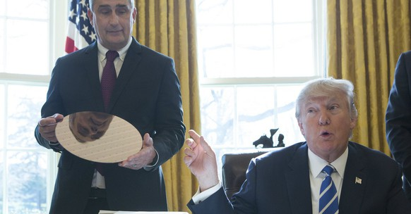 epa05778786 US President Donald J. Trump speaks during a meeting with Intel CEO Brian Krzanich at The White House in Washington, DC, USA, 08 February 2017, where Intel announced an investment of $7 billion to build a factory in Chandler, Ariz. to create advanced semi-conductor chips.  EPA/Chris Kleponis / POOL