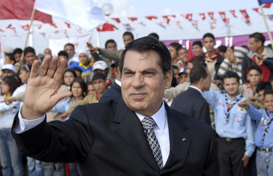 FILE - In this Nov.7, 2007 file photo, Tunisian President Zine EL Abidine Ben Ali waves to supporters in Rades, outside Tunis, before celebrations marking the 20th anniversary of Ben Ali's presidency. Tunisia's autocratic ruler Zine El Abidine Ben Ali, toppled in 2011, died in exile in Saudi Arabia. (AP Photo/Hassene Dridi, File) Ben Ali,Zine EL Abidine Ben Ali