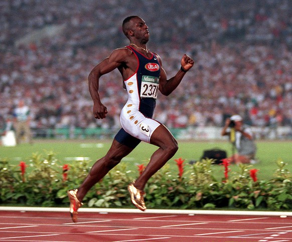 FILE - This is a Thursday Aug. 1, 1996 file photo of   Michael Johnson of the United States runs clear to win the men's 200 meters in a new world record time of 19.32 at the 1996 Summer Olympic Games in Atlanta.  Athletics great Michael Johnson will work with the Williams Formula One team to help its crew speed up drivers' pit stops.  Williams F1 said Wednesday Jan. 11, 2012  that Michael Johnson Performance Inc., the training company founded by the retired  200-meter and 400-meter Olympic champion, will devise a training program for its pit crew and evaluate the whole team's regime.(AP Photo/Michael Probst, File)