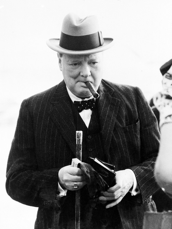 FILE - This Aug. 23, 1939 file photo shows Winston Churchill. A cigar once half-smoked by British Prime Minister Winston Churchill during a 1947 trip to Paris has sold for just over $12,000 during an online auction. Boston-based RR Auction says the 4-inch (10-centimeter) cigar was bought Wednesday evening, Oct. 11, 2017, by a collector from Palm Beach, Florida. The buyer's name wasn't released. (AP Photo)
