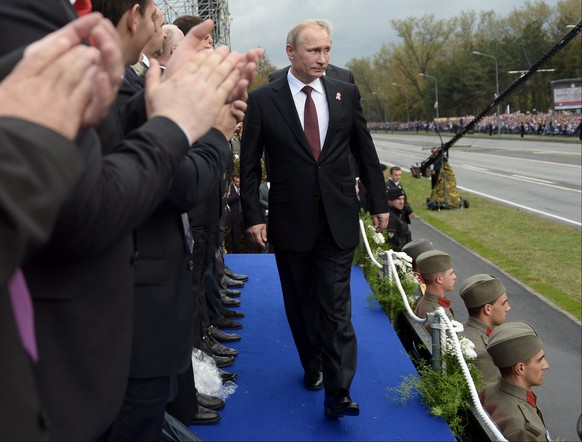 Russian President Vladimir Putin arrives to attend a military parade in Belgrade, Serbia, Thursday, Oct. 16, 2014. Greeted by enthusiastic chants of