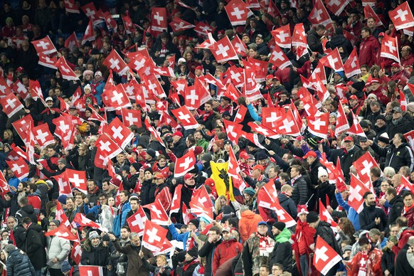 SwitzerlandÕs supporters with the Swiss flags cheer their team, prior the 2018 Fifa World Cup play-offs second leg soccer match Switzerland against Northern Ireland at the St. Jakob-Park stadium in Basel, Switzerland, Sunday, November 12, 2017. (KEYSTONE/Laurent Gillieron)
