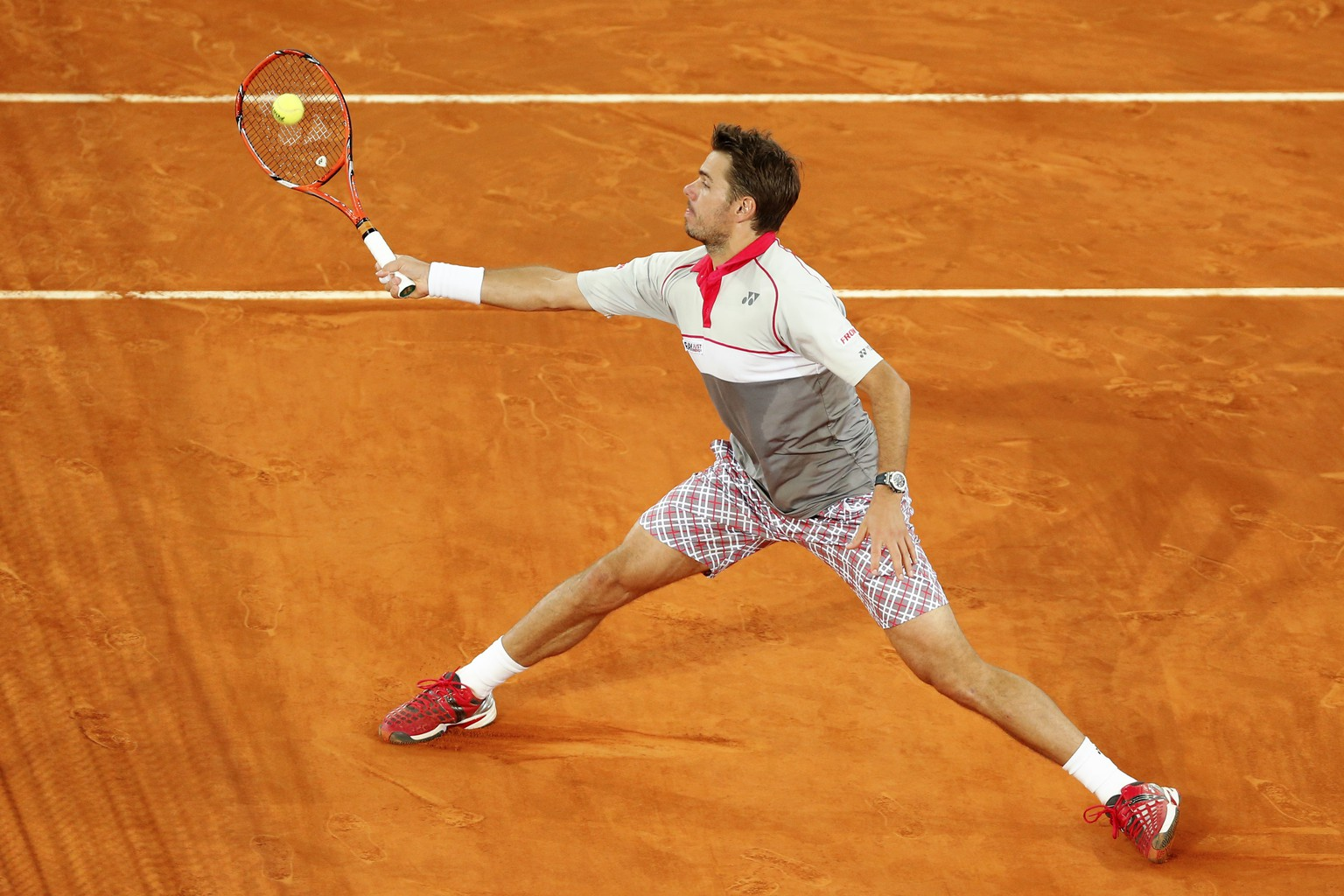 Stanislas Wawrinka from Switzerland returns the ball during the Madrid Open tennis tournament match against Joao Sousa from Portugal in Madrid, Spain, Tuesday, May 5, 2015. (AP Photo/Daniel Ochoa de Olza)