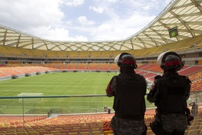 Riot police stand guard as FIFA's Secretary General Jerome Valcke tours the Arena Amazonia soccer stadium in Manaus, February 16, 2014. The stadium will host several matches of the 2014 World Cup. REUTERS/Bruno Kelly (BRAZIL - Tags: SPORT SOCCER)