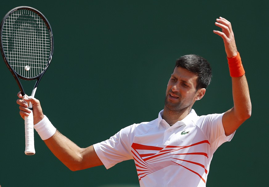 epa07515775 Novak Djokovic of Serbia reacts during his quarterfinal match against Daniil Medvedev of Russia at the Monte-Carlo Rolex Masters tournament in Roquebrune Cap Martin, France, 19 April 2018.  EPA/SEBASTIEN NOGIER