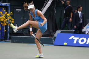 Martina Hingis of Switzerland returns a shot against Manuela Maleeva of Switzerland during their exhibition match at the Pan Pacific Open Tennis tournament in Tokyo Sunday, Sept.  21, 2014. (AP Photo/Shizuo Kambayashi)
