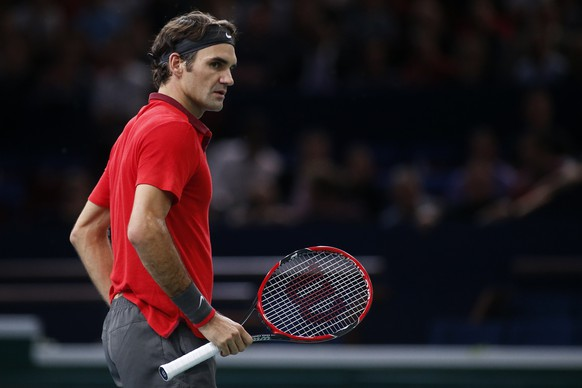 Switzerland's Roger Federer reacts during his men's singles tennis match against Lucas Pouille of France in the third round of the Paris Masters tennis tournament at the Bercy sports hall in Paris, October 30, 2014. REUTERS/Benoit Tessier (FRANCE - Tags: SPORT TENNIS)