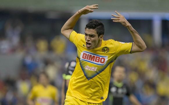 America's Raul Jimenez, celebrates after scoring against Santos during a Mexican soccer league match in Mexico City, Wednesday, April 30, 2014. (AP Photo/Eduardo Verdugo)
