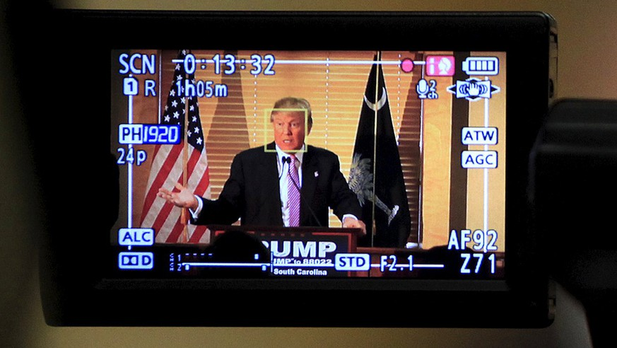 U.S. Republican presidential candidate Donald Trump speaks at a news conference, as seen through a video camera, at the Hanahan Town Hall in Hanahan, South Carolina February 15, 2016.  REUTERS/Randall Hill