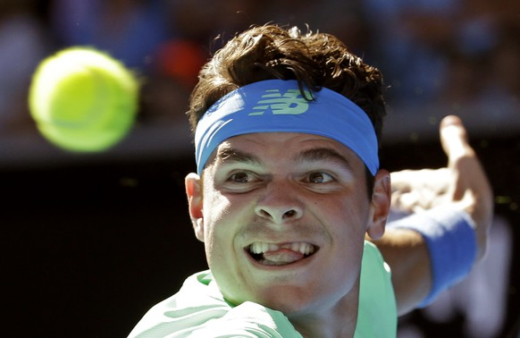 Canada's Milos Raonic eyes on the ball for a return to Luxembourg's Gilles Muller during their second round match at the Australian Open tennis championships in Melbourne, Australia, Thursday, Jan. 19, 2017. (AP Photo/Aaron Favila)