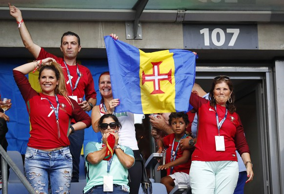 Football Soccer - Portugal v France - EURO 2016 - Final - Stade de France, Saint-Denis near Paris, France - 10/7/16 Mother and son of Portugal's Cristiano Ronaldo, Dolores Aveiro and Cristiano Jr in the stands with other family members before the game REUTERS/Kai Pfaffenbach Livepic