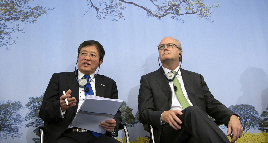 epa05141051 Ren Jianxin (L), Chairman of ChemChina (China National Chemical Corporation) and Michel Demare, Chairman of the Board during the annual press conference of agrochemical company Syngenta in Basel, Switzerland, 03 February 2016. The state-owned China National Chemical Corporation (ChemChina) has agreed to buy Swiss pesticide and seeds giant Syngenta for 43 billion dollars, which would be the biggest ever foreign acquisition by a Chinese firm.  EPA/GEORGIOS KEFALAS