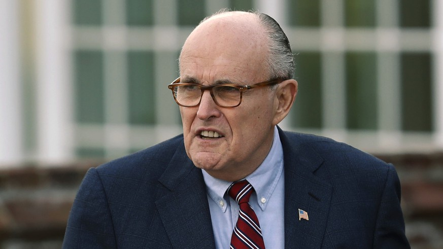 FILE - In this Nov. 20, 2016, file photo, former New York Mayor Rudy Giuliani arrives at the Trump National Golf Club Bedminster clubhouse in Bedminster, N.J. Giuliani, now an attorney for Trump, says the president didn't know the full details of his personal lawyer's arrangement with a porn actress until