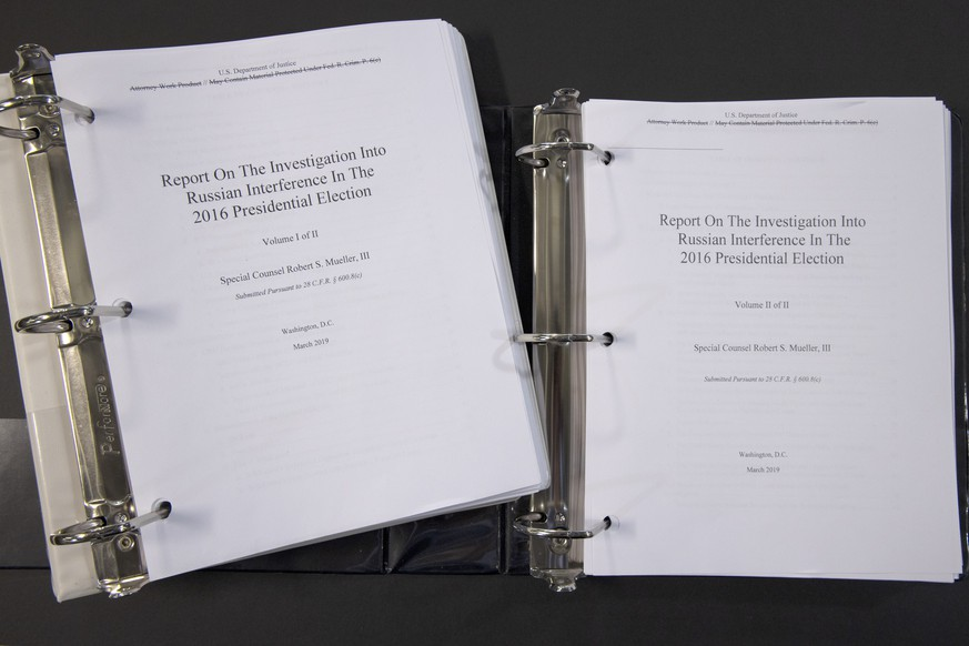 Special counsel Robert Mueller's redacted report on the investigation into Russian interference in the 2016 presidential election is photographed Thursday, April 18, 2019, in Washington. The report contained two volumes. (AP Photo/Jon Elswick)