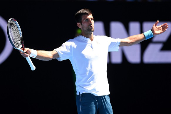 epa05729393 Novak Djokovic of Serbia reacts during his Men's Singles second round match against Denis Istomin of Uzbekistan at the Australian Open Grand Slam tennis tournament in Melbourne, Australia, 19 January 2017.  EPA/DEAN LEWINS AUSTRALIA AND NEW ZEALAND OUT