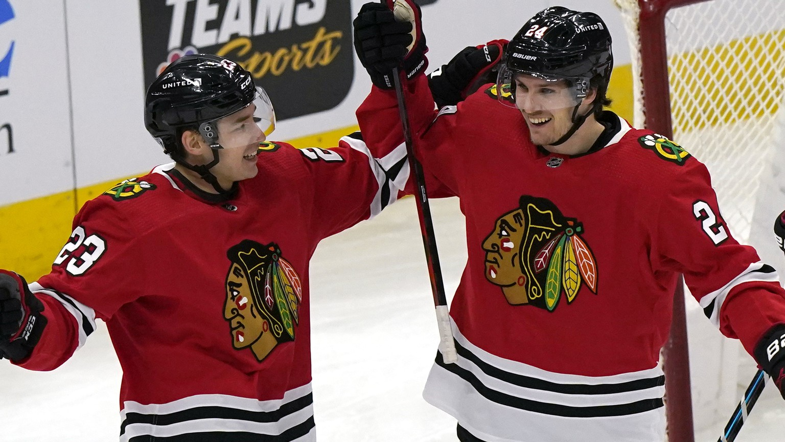 Chicago Blackhawks center Pius Suter, right, celebrates with left-wing Philipp Kurashev after scoring his second goal against the Detroit Red Wings during the first period of an NHL hockey game in Chicago, Sunday, Jan. 24, 2021.  (AP Photo/Nam Y. Huh) Pius Suter,Philipp Kurashev
