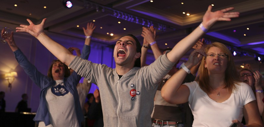 No supporters react to results in the Scottish independence referendum at the Marriott Hotel in Glasgow, Scotland as ballet papers are counted through the nigh Friday, Sept. 19, 2014. From the capital of Edinburgh to the far-flung Shetland Islands, Scots embraced a historic moment - and the rest of the United Kingdom held its breath - after voters turned out in unprecedented numbers for an independence referendum that could end Scotland's 307-year union with England. (AP Photo/PA, Lynne Cameron) UNITED KINGDOM OUT, NO SALES, NO ARCHIVE