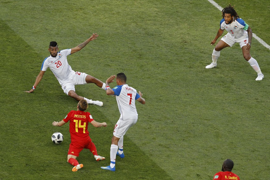 Belgium's Dries Mertens, left, is tackled by Panama's Blas Perez, second right, during the group G match between Belgium and Panama at the 2018 soccer World Cup in the Fisht Stadium in Sochi, Russia, Monday, June 18, 2018. (AP Photo/Victor R. Caivano)