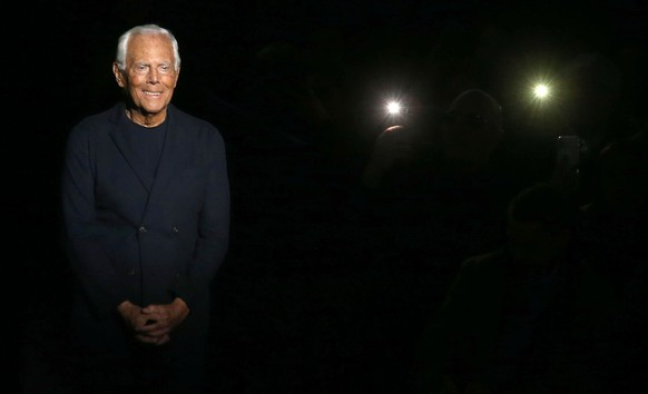 epa08125420 Italian fashion designer Giorgio Armani appears on the runway after the show by his label during the Milan Fashion Week Men's, in Milan, Italy, 13 January 2020. The Fall-Winter 2020/21 men's collections are presented at the Milano Moda Uomo from 10 to 14 January.  EPA/MATTEO BAZZI