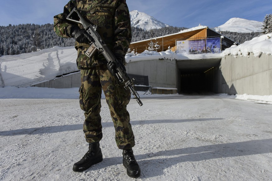 epa05109220 A Swiss Army soldier patrols outside the Congress Center two days before the opening of the 46th Annual Meeting of the World Economic Forum, WEF, in Davos, Switzerland, 18 January 2016. The overarching theme of the Meeting, which will take place from from 20 to 23 January, is 'Mastering the Fourth Industrial Revolution.'  EPA/JEAN-CHRISTOPHE BOTT