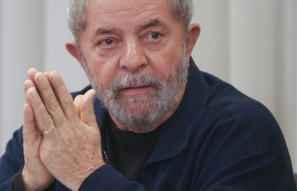FILE - In this March 30, 2015, file photo, Brazil's former President Luiz Inacio Lula da Silva attends an extraordinary Worker's Party leaders' meeting in Sao Paulo, Brazil. Federal police officer Jose Cyrispiniano confirmed Friday, March 4, 2016, that the police are at addresses belonging to Silva, including the Instituto Lula, his nonprofit organization. Cyrispiniano said police are acting on a warrant that requires Silva to answer their questions as part of the ongoing probe into corruption at Brazil's Petrobras oil giant. (AP Photo/Andre Penner, File)