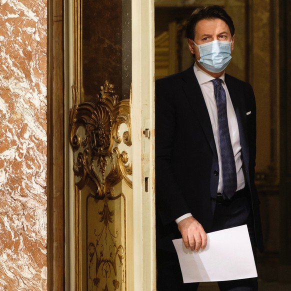 FILE-- Italian Premier Giuseppe Conte arrives for a press conference at Palazzo Chigi in Rome, Italy, Friday, Dec. 18, 2020. Conte intends to offer his resignation on Tuesday, Jan. 26, 2021, his office said Monday, a move seen as gamble that the embattled leader will get a fresh mandate from the president to try to forge a more viable coalition.(Mauro Scrobogna/LaPresse via AP)