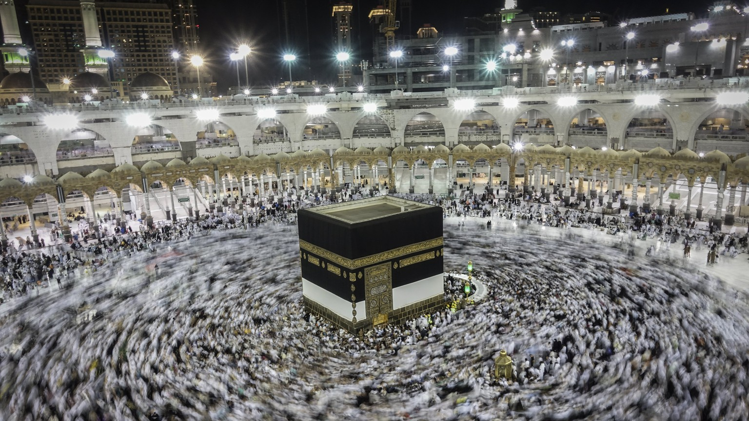epa06170838 A slow shutter speed picture shows Muslim worshippers praying around the holy Kaaba at the Grand Mosque in Mecca, Saudi Arabia, 29 August 2017. Around 2.6 million muslim are expected to attend this year's Hajj pilgrimage, which is highlighted by the Day of Arafah, one day prior to Eid al-Adha. Eid al-Adha is the holiest of the two Muslims holidays celebrated each year, it marks the yearly Muslim pilgrimage (Hajj) to visit Mecca, the holiest place in Islam. Muslims slaughter a sacrificial animal and split the meat into three parts, one for the family, one for friends and relatives, and one for the poor and needy.  EPA/MAST IRHAM