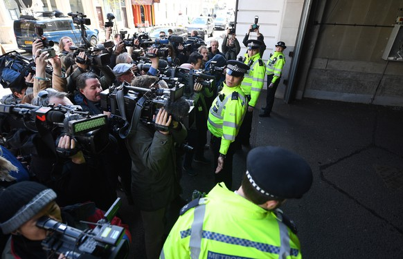 epa07498666 Police hold back the media from a vehicle at Westminster Magistrates Court in London, Britain, 11 April 2019. Wikileaks founder Julian Assange was due to appear before the Westminister Court after he was arrested in London on 11 April.  EPA/ANDY RAIN