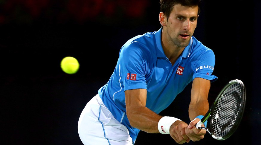 DUBAI, UNITED ARAB EMIRATES - FEBRUARY 26:  Novak Djokovic of Serbia plays a backhand against Marsel Ilhan of Turkey during their men's singles quarterfinal match of the ATP Dubai Duty Free Tennis Championships at the Dubai Duty Free Stadium on February 26, 2015 in Dubai, United Arab Emirates.  (Photo by Francois Nel/Getty Images)