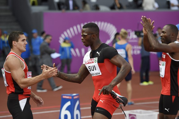Switzerland's Pascal Mancini, Reto Amaru Schenkel and Alex Wilson, from left to right, react after setting a new swiss national record in the men's 4x100m relay round 1 race, at the fifth day of the European Athletics Championships in the Letzigrund Stadium in Zurich, Switzerland, Saturday, August 16, 2014. (KEYSTONE/Jean-Christophe Bott)