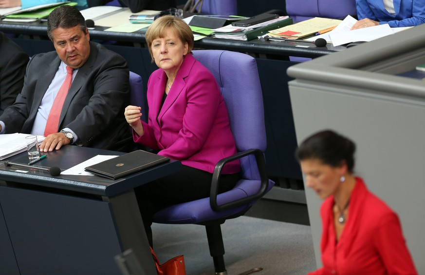 BERLIN, GERMANY - JUNE 04:  German Chancellor Angela's Merkel (CDU) (C) listens next to Vice Chancellor and Economy and Energy Minister Sigmar Gabriel (SPD) (L) as Sahra Wagenknecht of the Left party (Die Linken) criticizes Merkel's policies during a meeting of the Bundestag, the German federal parliament, on June 4, 2014 in Berlin, Germany. Merkel spoke in the Bundestag after attending a meeting in Brussels with the 28 European Union heads of state, where she continued to back Jean-Claude Juncker, leading candidate for the European People's Party (EPP) and former prime minister of Luxembourg, for the position of European Commission president.  (Photo by Adam Berry/Getty Images)