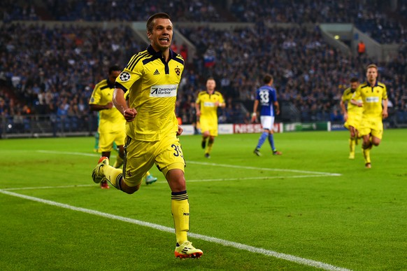 GELSENKIRCHEN, GERMANY - SEPTEMBER 30:  Damjan Bohar of NK Maribor celebrates with team-mates after scoring the opening goal during the UEFA Champions League group G match between FC Schalke 04 and NK Maribor at Veltins Arena on September 30, 2014 in Gelsenkirchen, Germany.  (Photo by Dennis Grombkowski/Bongarts/Getty Images)