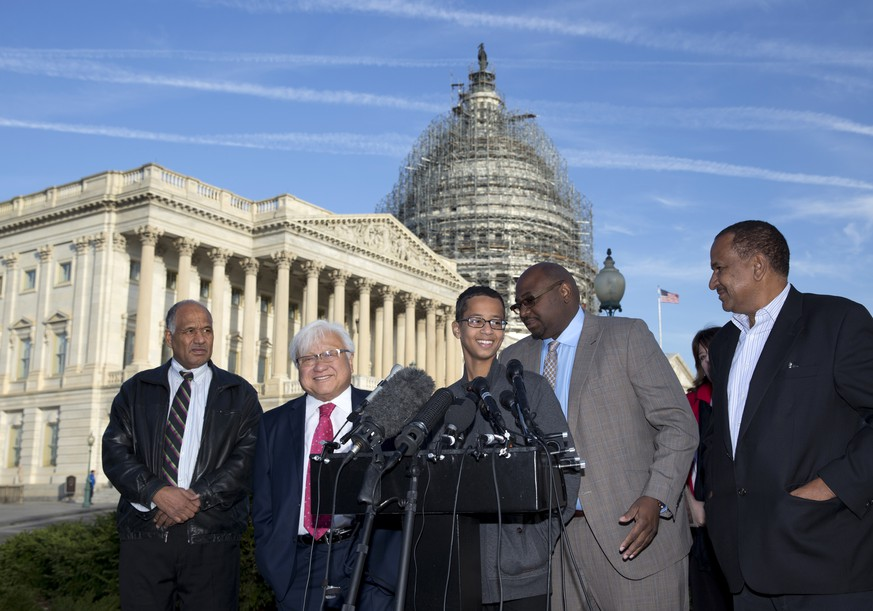 "Ahmed Mohamed, center, joined by from left, his father Mohamed Elhassan Mohamed, Rep. Mike Honda, D-Calif., Ron Price, and his uncle Aldean Mohamed, speaks during a news conference on Capitol Hill in Washington, Tuesday, Oct. 20, 2015. Ahmed Mohamed is the 14-year-old ""clock kid"", freshman, who was arrested in Irving, Texas, for bringing an alarm clock science project to his high school teacher. (AP Photo/Carolyn Kaster)"
