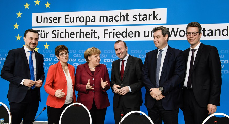 epa07462019 (L-R)  Christian Democratic Union (CDU) Secretary General Paul Ziemiak, CDU party chairwoman Annegret Kramp-Karrenbauer, German Chancellor Angela Merkel, European People's Party (EPP) chairman Manfred Weber, Christian Social Union (CSU) chairman Markus Soeder and Secretary General of the Christian Social Union (CSU) party Markus Blume during the beginning of a party board meeting in Berlin, Germany, 25 March 2019. The CDU and CSU gathered for a joint board meeting on the occasion of the passage of an electoral program for the European elections 2019.  EPA/CLEMENS BILAN