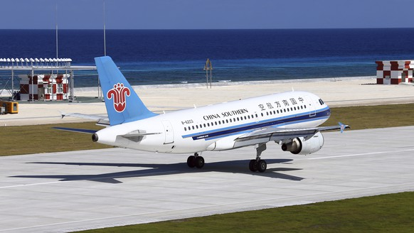 In this Wednesday, Jan. 6, 2016 photo released by China's Xinhua News Agency, a China Southern Airlines jetliner lands at the airfield on Fiery Cross Reef, know as Yongshu Reef of the South China Sea. A pair of Chinese civilian jet airliners landed at the newly created island in a disputed section of the South China Sea in a test to see whether its airstrip was up to standard, state media reported Thursday, Jan. 7. The China Daily newspaper said the two planes on Wednesday made the two-hour flight to Fiery Cross Reef from Haikou on the southern island province of Hainan. (Cha Chunming/Xinhua via AP)  NO SALES