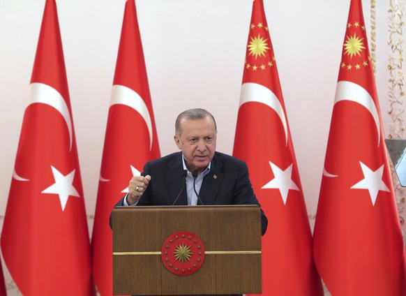 Turkey's President Recep Tayyip Erdogan speaks during an event in Ankara, Turkey, Saturday, May 8, 2021. In a speech after the breaking of Ramadan fast late Saturday, Erdogan, has strongly condemned violence in Jerusalem. On Friday, more than 200 Palestinians were wounded in clashes at the Al-Aqsa Mosque compound and elsewhere in Jerusalem, drawing condemnations from Israel's Arab allies and calls for calm from the United States, Europe and the United Nations. (Turkish Presidency via AP)