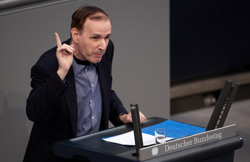 epa06491312 Dr. Gottfried Curio of the Alternative for Germany party (AfD) gives a speech during a session of the German parliament 'Bundestag' in Berlin, Germany, 02 February 2018. At the request of the Alternative for Germany (AfD) party, the Bundestag debates on the temporally limited dual citizenship.  EPA/HAYOUNG JEON