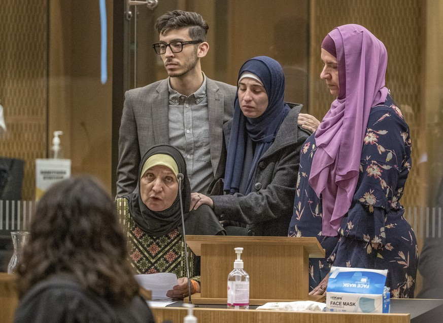 Maysoon Salama, mother of a Mosque shooting victim, with her family, speaks to shooter 29-year-old Australian Brenton Harrison Tarrant at the Christchurch High Court for sentencing after pleading guilty to 51 counts of murder, 40 counts of attempted murder and one count of terrorism in Christchurch, New Zealand, Monday, Aug. 24, 2020. More than 60 survivors and family members will confront the New Zealand mosque gunman this week when he appears in court to be sentenced for his crimes in the worst atrocity in the nation's modern history. (John Kirk-Anderson/Pool Photo via AP)