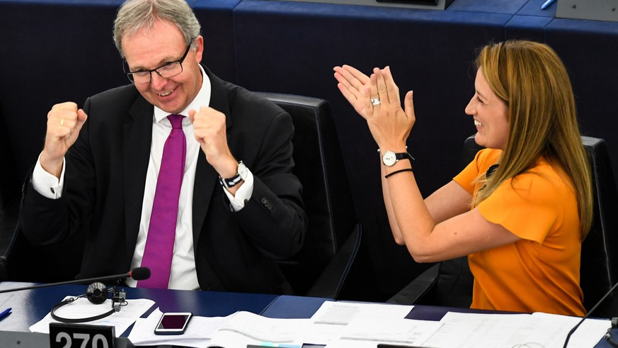 epa07014587 Rapporteur Axel Voss (L)  from the Group of the European People's Party (Christian Democrats) and Roberta Metsola (R) from the Group of the European People's Party (Christian Democrats) react in a vote on modifications to EU copyright reforms during a voting session at the European Parliament in the European Parliament in Strasbourg, France, 12 September 2018.  EPA/PATRICK SEEGER